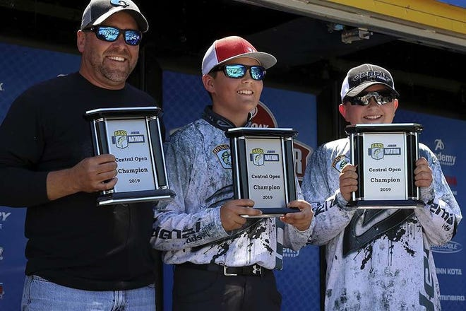 Salem's Keaton Bassham and Huntlee Yorkwon the Bassmaster Junior Central Open held Sunday on Norfork Lake, featuringanglers in second through eighth grades. Bassham and York caught the only limit, which weighed 10 pounds, 5 ounces. The duo is pictured with boat captain Michael Bassham and will advance to the national tournament in Tennessee.