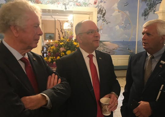 Gov. John Bel Edwards, center, discusses last week's tragic twister in Ruston with energy and trucking titan James Davison, left, and Ruston Mayor Ronny Walker.