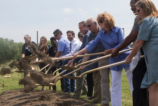Various West Monroe officials and other community representatives shovel dirt during the ground breaking ceremony of the Riverbend Community Health Park located next to the West Monroe Community Center and Riverbend elementary on April 30 in West Monroe, La.