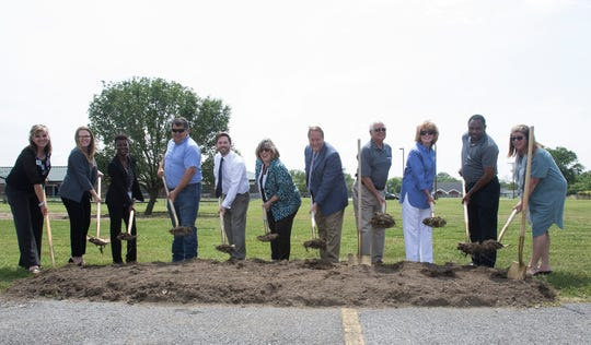 Various West Monroe officials and other community representatives pose for a photo during the ground breaking ceremony of the Riverbend Community Health Park located next to the West Monroe Community Center and Riverbend elementary on April 30 in West Monroe, La.