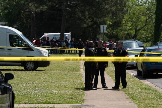 Emergency crews investigate a homicide at the Red Lion Apartments in Montgomery, Ala., on Tuesday, April 30, 2019.