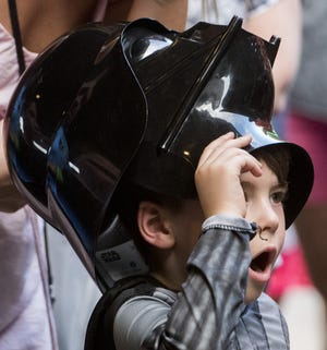 Emmett Chappell reacts as he sees the characters during Star Wars Night at the  Biscuits game.