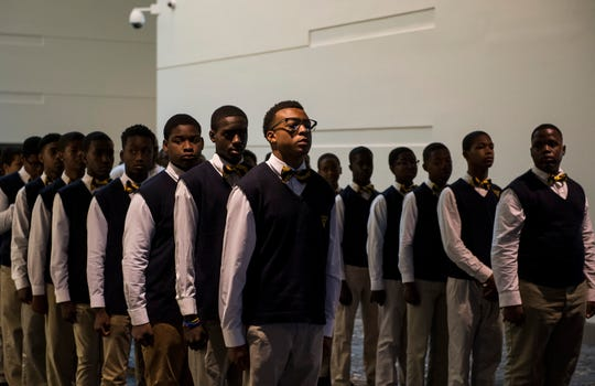 Scholars stand at attention before entering the ballroom during the Valiant Cross Breakfast with Scholars  in Montgomery, Ala., on Tuesday, April 30, 2019.