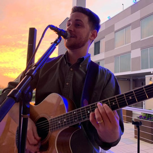 Brett Burcham performs Sunday as part of Music in May at The Waters.