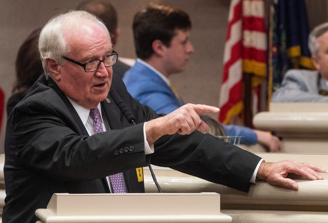 Rep. Lynn Greer discusses his local church security bill on the house floor at the Alabama Statehouse in Montgomery, Ala., on Tuesday April 30, 2019.