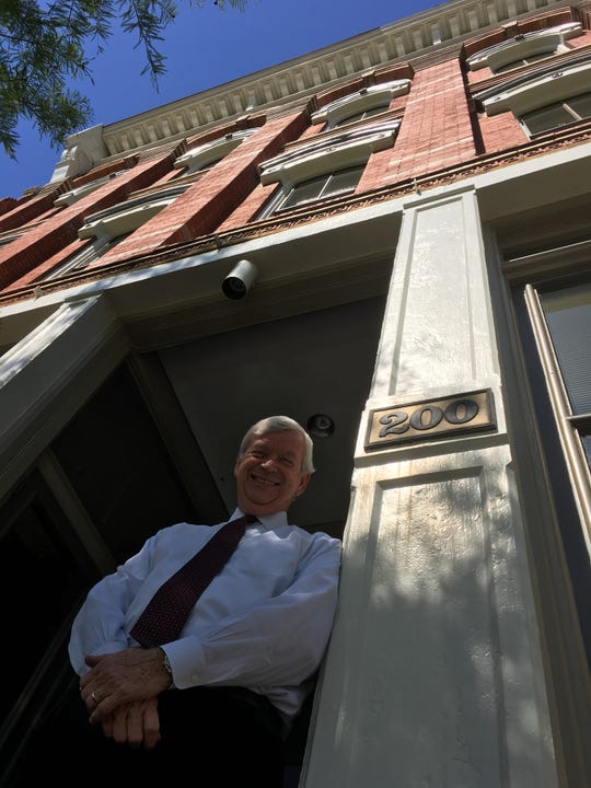 Jackson Thornton's President Ned Sheffield stands outside the firm's 1894 building in downtown Montgomery.