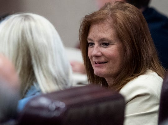 Rep. Terri Collins chats on the house floor at the Alabama Statehouse in Montgomery, Ala., on Tuesday April 30, 2019. Collins is the sponsor of the abortion ban bill.