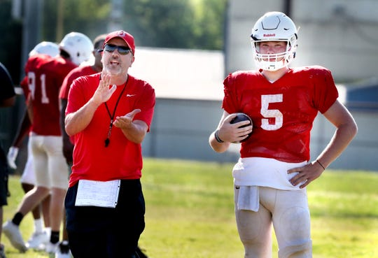 Oakland coach Kevin Creasy instructs players as senior quarterback Kody Sparks (5) looks on during a spring practice. The Patriots are hoping to repeat as state champions in Class 6A.