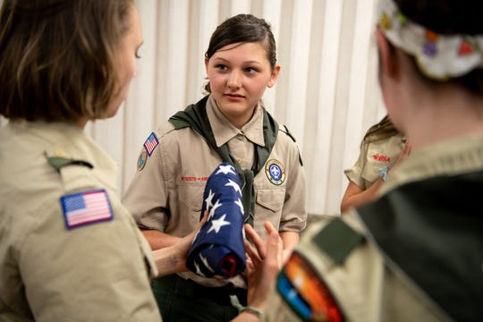 Hope Bakken, 13, works with other Scouts on a flag folding lesson during a Scouts BSA meeting at Christ Community Church in Franklin on April 29, 2019.