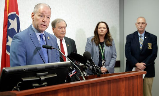 Tennessee Bureau of Investigation Director David Rausch, left, speaks at a news conference at the Tennessee Bureau of Investigation Monday, April 29, 2019, in Nashville, Tenn., regarding the killing of seven people in rural Tennessee on Saturday, April 27. Officials say the people killed in two homes include the parents of the suspect, 25-year-old Michael Cummins.