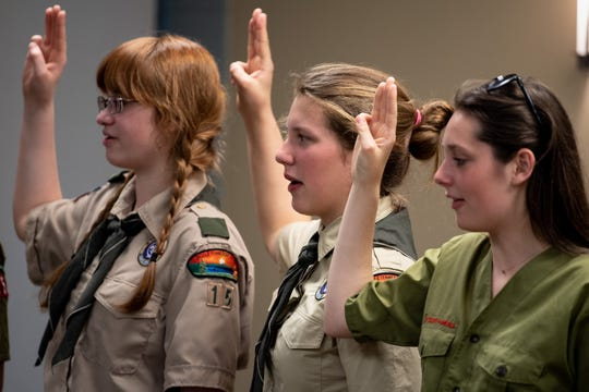 Estella Pennell, center, 17, recites the Scout Oath during a Scouts BSA meeting at Christ Community Church in Franklin on April 29, 2019.