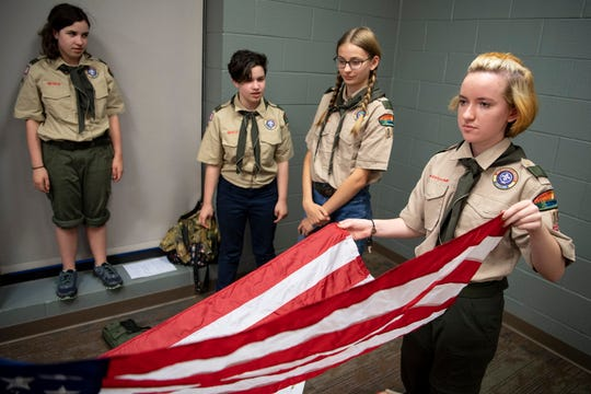 Corinna Vollmer, 14, practices flag folding during a Scouts BSA meeting at Christ Community Church in Franklin on April 29, 2019.