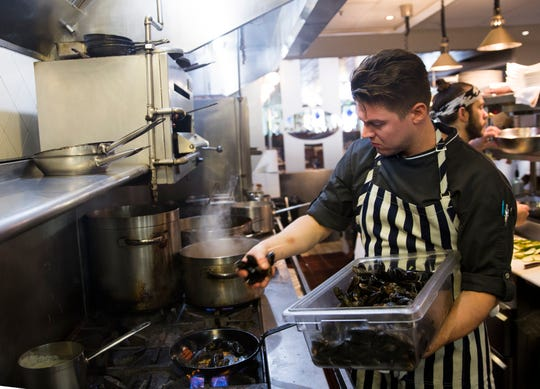 Executive Chef Josh Zeman prepares lunch at Sea Salt in November 2016 in downtown Naples. Zeman will host cooking classes at the local restaurant this spring.