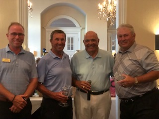 Vasari head professional Chris Evans (left) with men's winner Jim Cox, Vasari Cares Foundation president Steve Evangelista, and men's winner Jack Enoches.