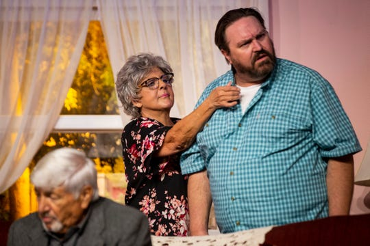 Kathleen Barney fixes Sean O'Shea's collar as they act out a scene during a dress rehearsal of Over the River and Through the Woods by the Studio Players at the Golden Gate Community Center in Naples on Monday, April 29, 2019.