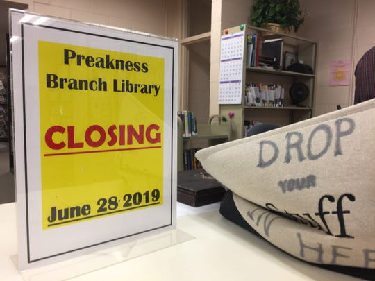 A flier inside of the Preakness branch of the Wayne Public Library announces its upcoming closing.