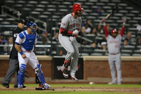 Cincinnati Reds left fielder Jesse Winker (33) reacts after hitting the game winning home run against the New York Mets during the ninth inning at Citi Field.