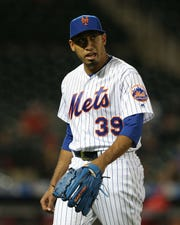 New York Mets relief pitcher Edwin Diaz (39) reacts during the ninth inning against the Cincinnati Reds at Citi Field.