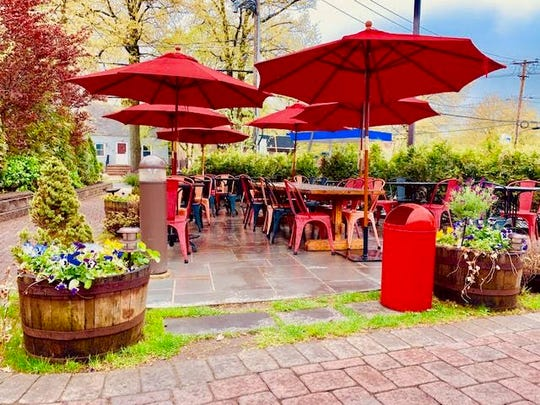 Umbrellas give shade to diners on the patio of The Farmhouse Cafe & Eatery in Cresskill