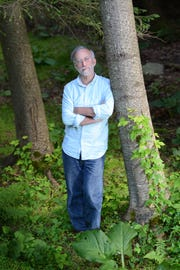 Gary Oppenheimer stands in his thickly wooded backyard in West Milford, N.J.