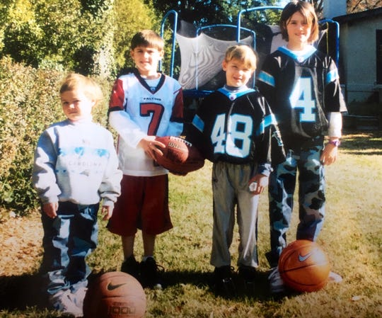 NY Giants draft pick Daniel Jones, second from left, was a fan of numerous quarterbacks growing up in addition to soon-to-be-teammate Eli Manning. Here is Jones wearing Michael Vick's Atlanta Falcons jersey.