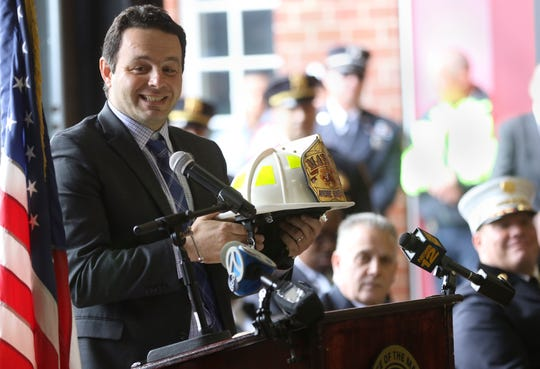 Paterson Mayor, Andre Sayegh, is shown after receiving a fire fighters hat from Paterson Fire Department Chief, Brian McDermott (background).  Tuesday, April, 30, 2019