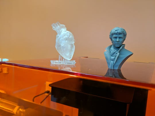 3D printed sculptures sit on top of a 3D printer at the BCC STEM Center, which opened on April 30.