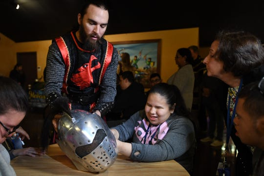 Students from St. Joseph's School for the Blind in Jersey City visit Medieval Times in Lyndhurst on Tuesday, April 30, 2019. (center) Student Anna Santana holds a helmet with help from Medieval Times knight Kyle Watkins.