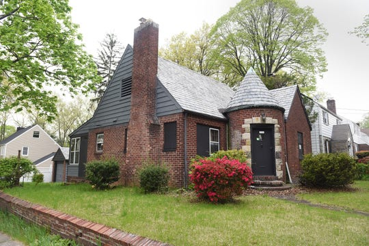 Exterior photo of the house located at 976 Alpine in Teaneck where Joan Davis, a well known gadfly in town, was murdered 9 years ago.  The house was set on fire and the case remains unsolved. Township officials have discussed purchasing the house and knocking it down to turn the property into open space.