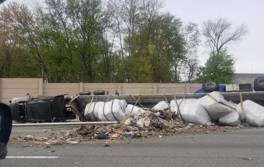 An overturned truck spills debris on an entrance ramp onto Route 80 from Route 287 in Parsippany April 30, 2019.