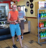 Formerly from Chicago, Paul Mach and Frank Belyam, who were picking up pizzas Tuesday April 30, 2019, said they love Papa Murphy's stuffed pizza. The pizzeria has been accommodating to their dietary needs.