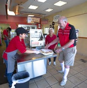 George Duncan and his wife, Mytsuko, pick up a pizza at Papa Murphy's on Tuesday, April 30, 2019. They have been loyal Papa Murphy's customers for years, and are sad to see the Las Cruces store closing.