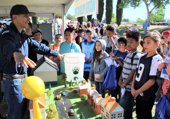 LCU Water Production Operator Horacio Palacios shows how water is pumped from under ground to homes. These fundamental lessons are what fourth-grades from across Las Cruces, gathered to learn all about water at the Las Cruces Utilities' Children's Water Festival.