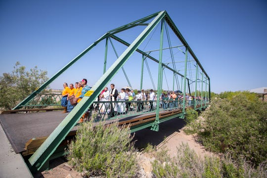 A procession crosses a bridge at the New Mexico Farm & Ranch Heritage Museum during the Blessing of the Fields ceremony, May 13, 2016.