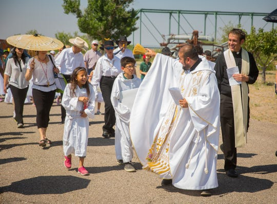 In this file photo, Alejandro Reyes, administrator of Our Lord of Mercy Catholic Church in Hatch, blesses children while walking in a procession during the Blessing of the Fields ceremony at the New Mexico Farm & Ranch Heritage Museum, May 13, 2016.