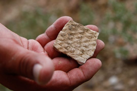 A pottery sherd is pictured, Tuesday, June 23, 2015, at Pierre's Ruins, 20-miles north of Chaco Culture National Historical Park. Two members of a panel appointed by the state's land commissioner to make recommendations on land uses in the Greater Chaco Area say they were not told they'd been appointed.
