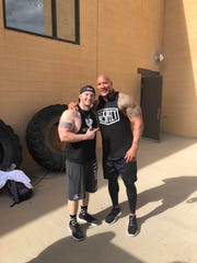 "Farmington resident Jordan Eddleman, left, stands with Dwayne ""The Rock"" Johnson after meeting the actor on April 26 in Farmington."