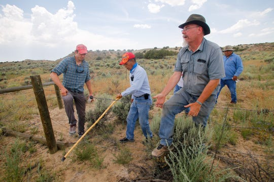 Archaeologist Paul Reed, seen in this 2015 file photo leading a tour of Pierre's Site near the edge of the 10 mile Chaco buffer zone, is a member of a new working group that advises the state's land commissioner on land uses in the Greater Chaco region.