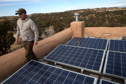 Mike Eisenfeld shows his solar panels, Friday, Dec. 1, 2017 at his home in Farmington. Eisenfeld is one of several Farmington residents suing the city based on a standby service rider charged to customers with solar panels. Eisenfeld has a 4.7 kilowatt rooftop solar array that was grandfathered into the system. He plans on installing a 7.89 kilowatt ground-mounted solar array, which would terminate the grandfathered status of his rooftop system, according to court documents.