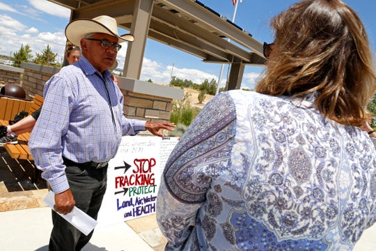 Among the members of a new working group advising the State Land Office's leader  on land uses in the Greater Chaco Area is Daniel Tso, seen here at left speaking on June 1, 2015, during a rally against fracking near Chaco at the Bureau of Land Management Farmington Field Office.