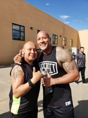 "From left, Farmington resident Leonard Castillo met actor Dwayne ""The Rock"" Johnson on April 26 in Farmington."