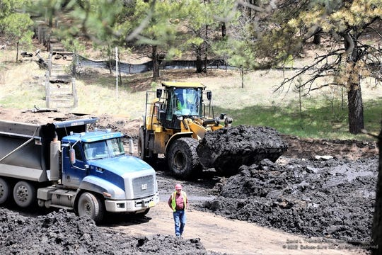 Material is dried to about 20 percent water and then loaded to be hauled to a quarry.