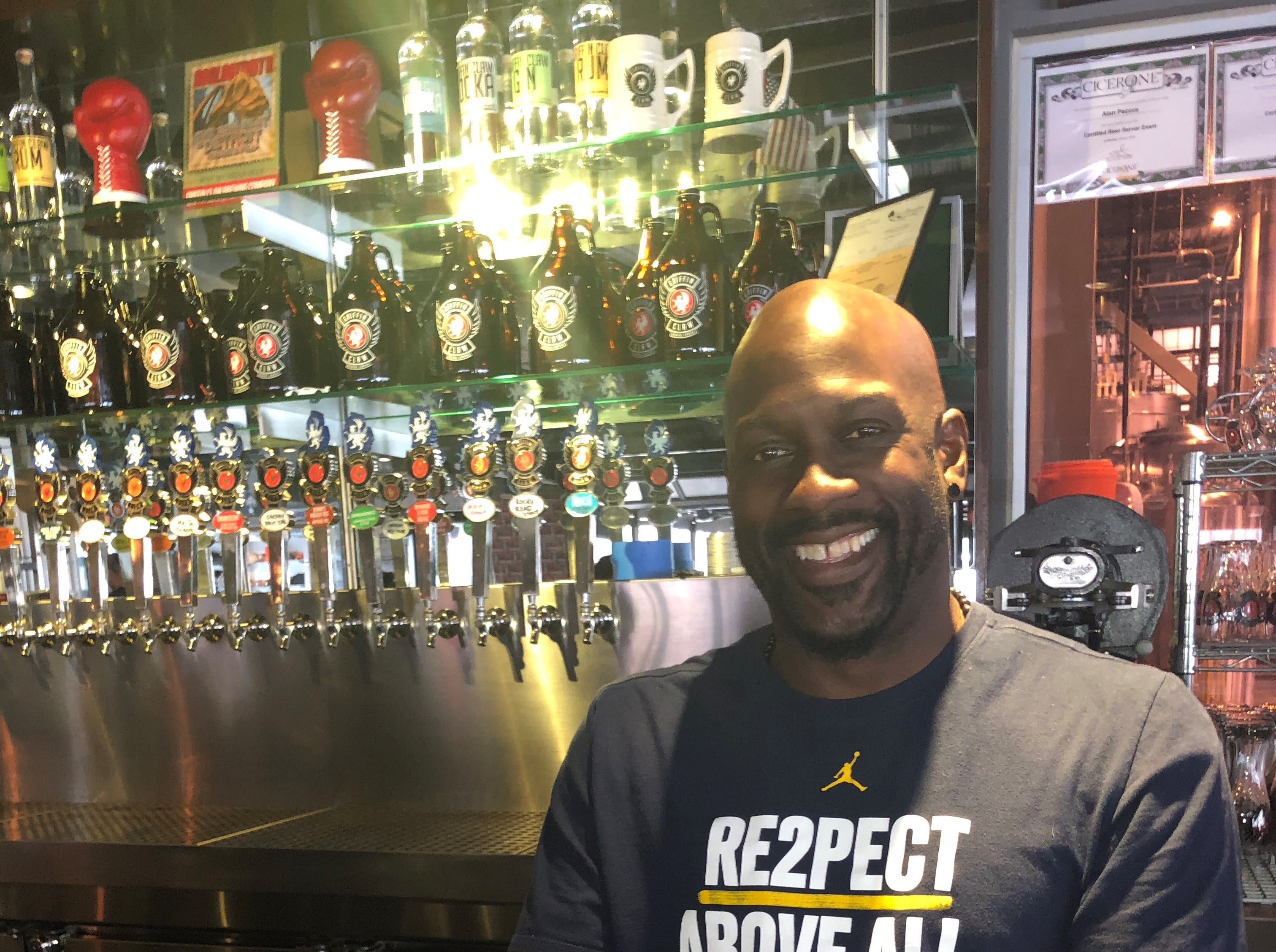 """Damon Works, bartender at Griffin Claw in Birmingham, with the brewery's winning ale, """"El Rojo."""""""