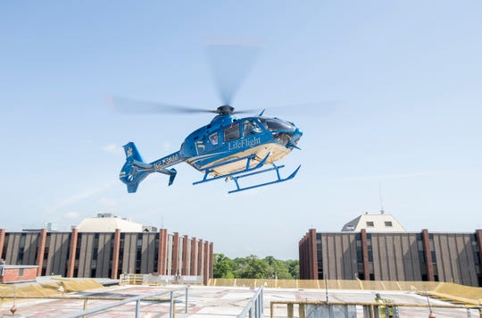A LifeFlight crew takes off in its new EC135 twin engine helicopter from Baptist Hospital in Pensacola on April 30.