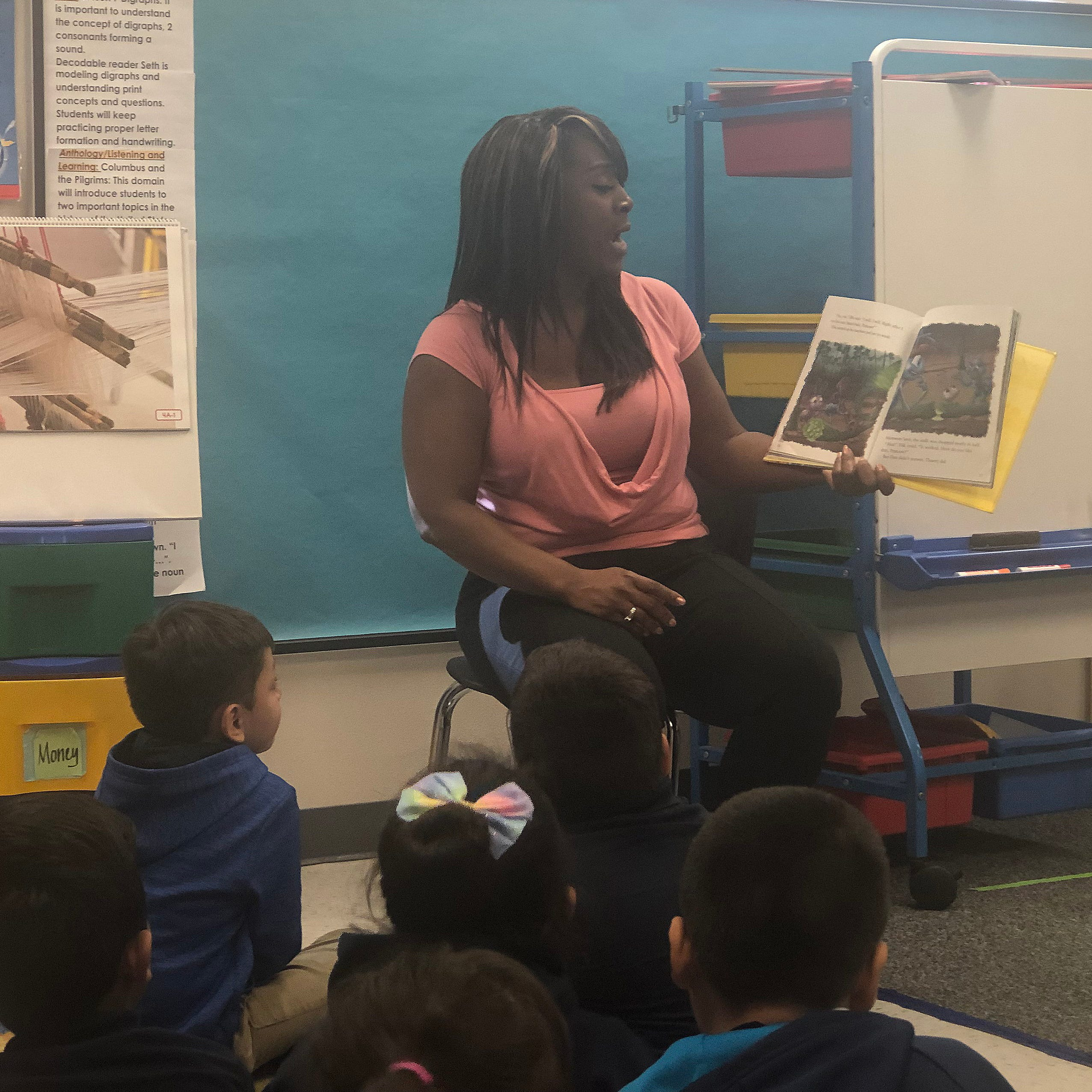 Substitute teacher Michelle Hicks reads to a kindergarten class at Pioneer Preparatory School in Phoenix.