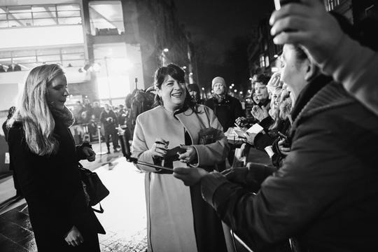 """E.L. James signs autographs at the London premiere of """"Fifty Shades Darker"""" on Feb. 9, 2017, in London."""