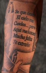 The tattoo on Yoan Lopez's right forearm helps him remember his mother.
