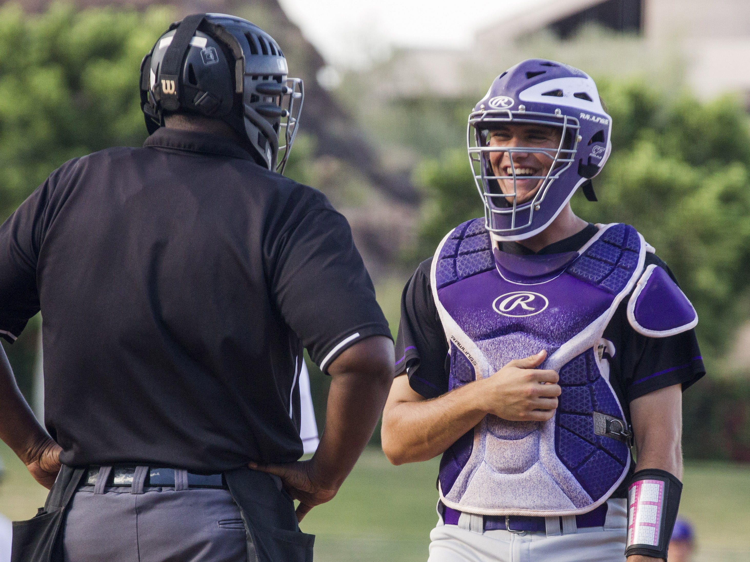 Sunrise Mountain's Ethan Snodgrass shares a laugh with the umpire as they play Desert Mountain during the 5A state baseball second round at Diablo Stadium in Tempe, Arizona, April 29, 2019.