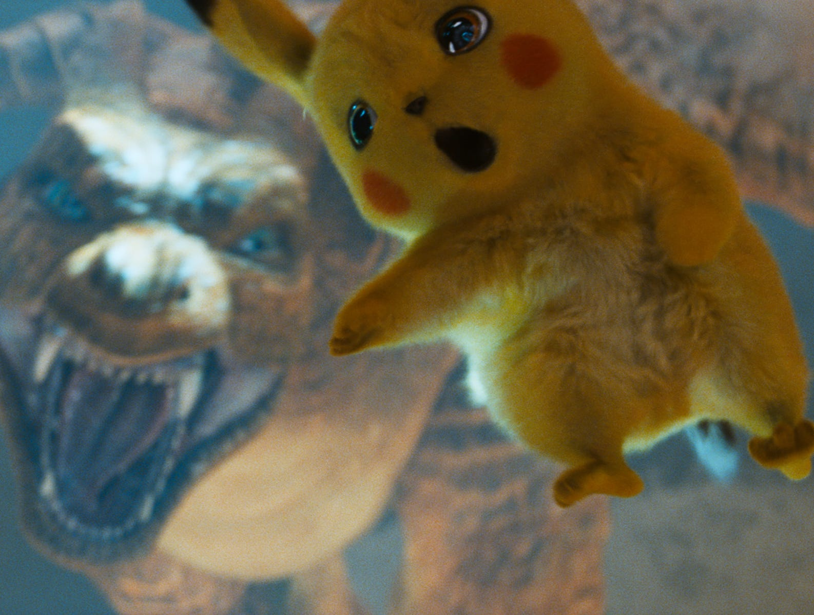 "Pikachu (voiced by Ryan Reynolds) fights a Charizard in an underground Pokemon battle arena in ""Pokemon Detective Pikachu."""