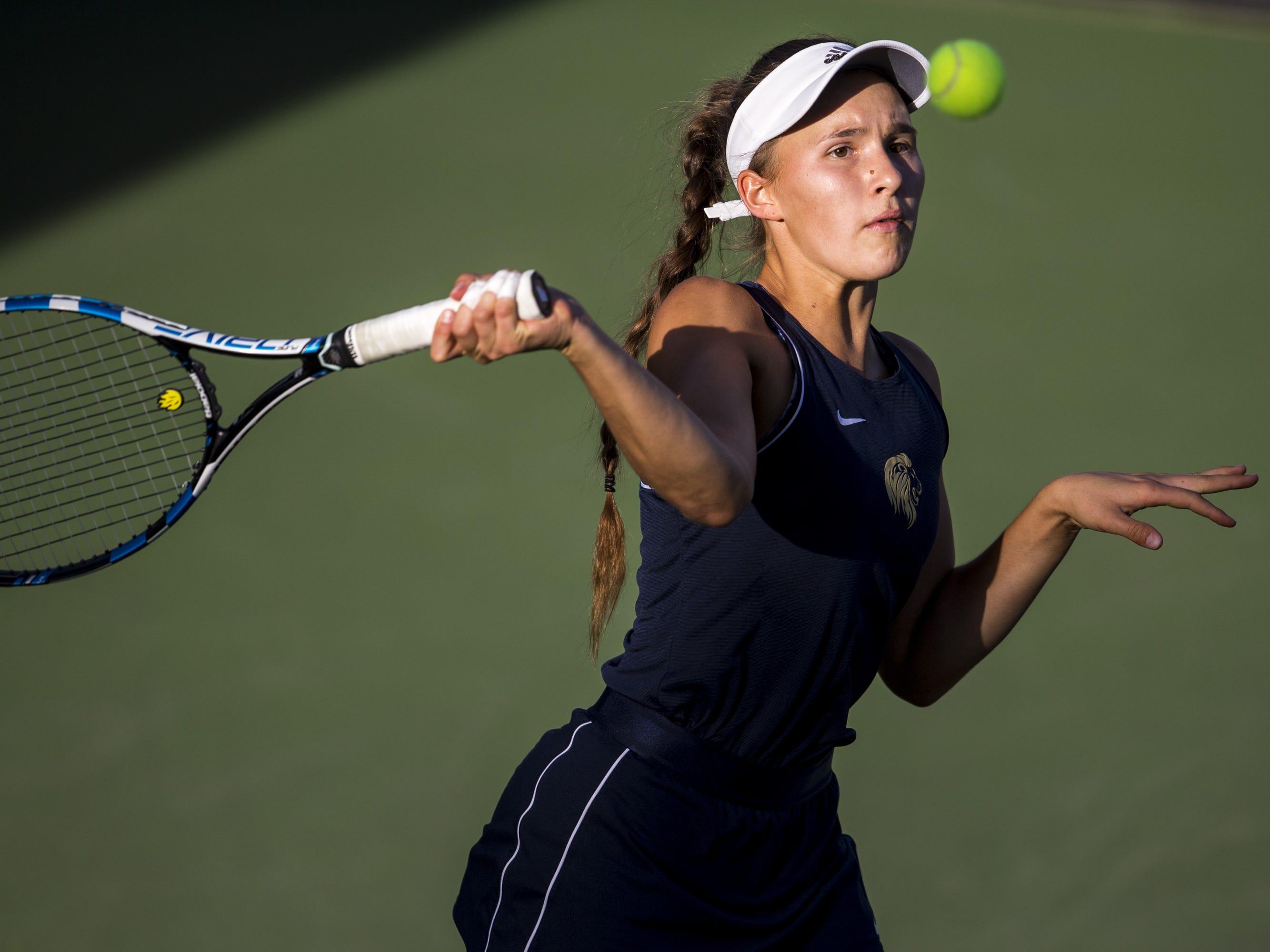 Pusch Ridge's Sofia Fetsis returns the ball against Chandler Prep's Sangeet Bhalla during the Division III Girls Tennis Singles State Championship on Monday, April 29, 2019, at Whiteman Tennis Center in Tempe, Ariz.